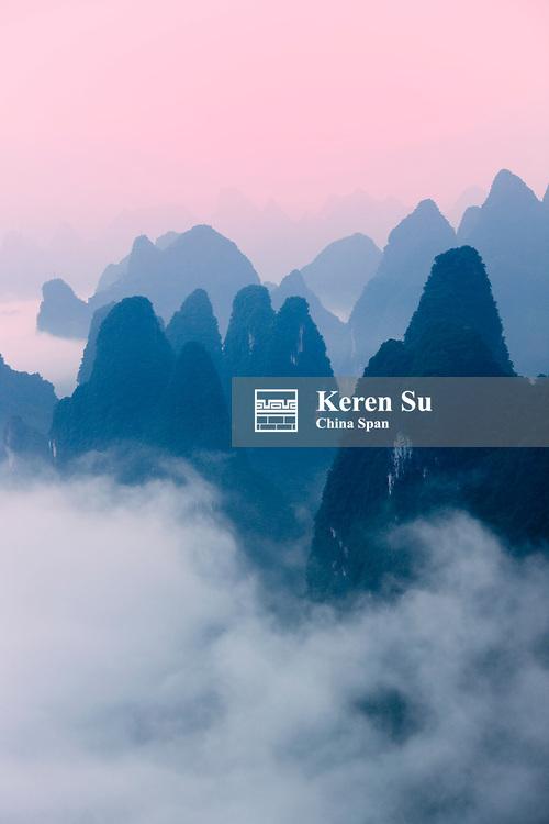 Karst hills in morning mist, Li River area, Yangshuo, Guangxi, China