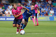 AFC Wimbledon Kosta Sparta (29) battles for possession during the Pre-Season Friendly match between AFC Wimbledon and Queens Park Rangers at the Cherry Red Records Stadium, Kingston, England on 14 July 2018. Picture by Matthew Redman.