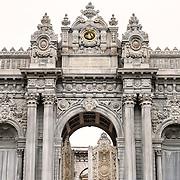 The Gate of the Sultan at Dolmabahçe Palace. Dolmabahçe Palace, on the banks of the Bosphorus Strait, was the administrative center of the Ottoman Empire from 1856 to 1887 and 1909 to 1922. Built and decorated in the Ottoman Baroque style, it stretches along a section of the European coast of the Bosphorus Strait in central Istanbul.