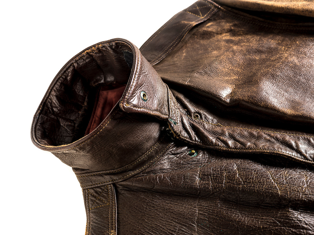 A-2 jacket that belonged to Captain Neal Workman, a B-24 pilot.  Note the addition of the collar strip, to which the collar was attached.  This is rare, as many collars were attached directly to the jacket.