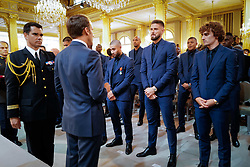 French president Emmanuel Macron awards Olivier Giroud next to Antoine Griezmann during a Legion of Honour award ceremony for French 2018 football World Cup winners at the Elysee Palace in Paris, on June 4, 2019. Photo by Hamilton/pool/ABACAPRESS.COM