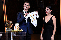 7 December 2017 -  Ballon d'Or 2017 - Cristiano Ronaldo and girlfriend Georgina Rodriguez pose with a baby-grow featuring five Ballon d'Or trophies - Photo: Presse Sports / Offside
