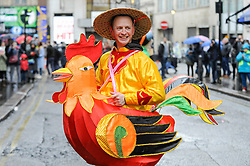 © Licensed to London News Pictures. 29/01/2017. London, UK.   A man in the parade wears a rooster costume, as the Chinese New Year parade takes place around Chinatown to celebrate the Year of the Rooster. Photo credit : Stephen Chung/LNP
