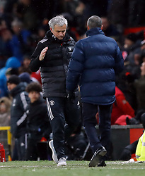Manchester United manager Jose Mourinho (left) and Brighton & Hove Albion manager Chris Hughton after the Emirates FA Cup, quarter final match at Old Trafford,Manchester