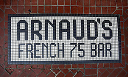 03 Sept 2014. New Orleans, Louisiana. <br /> Bar logo on the floor at the entrance to Arnaud's French 75 Bar in the French Quarter.<br /> Photo; Charlie Varley/varleypix.com