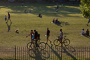 The number of UK deaths from Coronavirus, a further 363 victims taking the total to 35,704, coincides with the hottest day of the year so far, with 27.8 degrees recorded at Heathrow Airport, and Londoners - still under the UK governments lockdown rules of social distancing - enjoy a warm evening in Ruskin Park in Lambeth, south London, on 20th May 2020, in London, England.