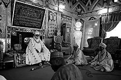 Sept. 23, 2010 - Kano, Nigeria - The Emir of Kano, His Royal Highness Alhaji Dr. Ado Bayero, holds court in his 15th century palace. The Emir supported the polio vaccine ban but now supports the immunization campaigns. Religious zealotry and misinformation have coerced villagers in the Muslim north of Nigeria into refusing polio vaccinations and led to the reemergence of polio only a few years after it nearly joined smallpox on the CDC's list of eradicated diseases. The polio vaccine was banned in northern Nigeria in the summer of 2003 due to claims by clerics and politicians that the vaccines were tainted and were a Western ploy to spread HIV and make the Muslim girls sterile. During the one year ban, over 3000 children were crippled by polio and over 20 countries re-infected with the Nigeria strain of the virus. (Credit Image: © Mary F. Calvert/ZUMAPRESS.com)