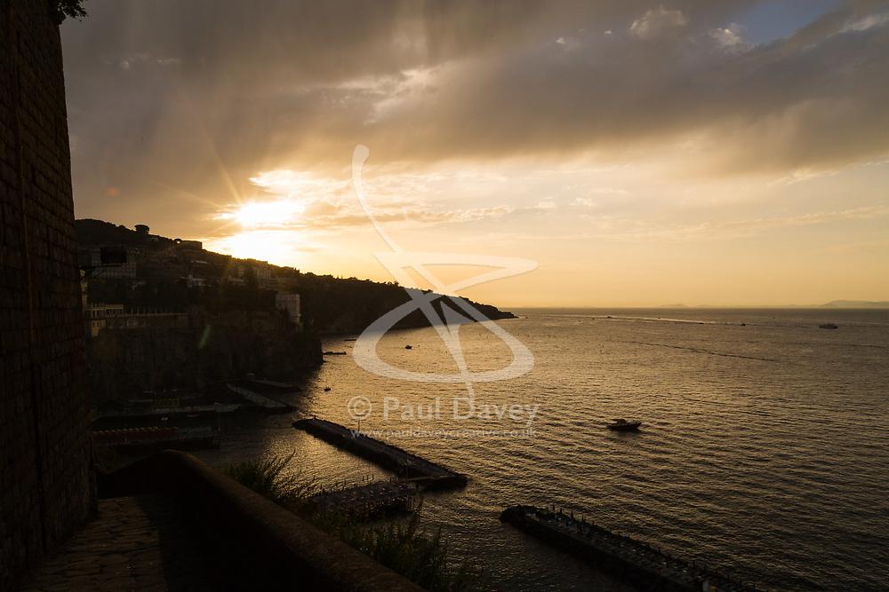 Sorrento, Italy, September 16 2017. The sun sets over Marina Santo Francesco, Sorrento, Italy. © Paul Davey