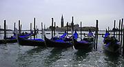 Gondolas moored at St Mark's square, Venice, Italy.