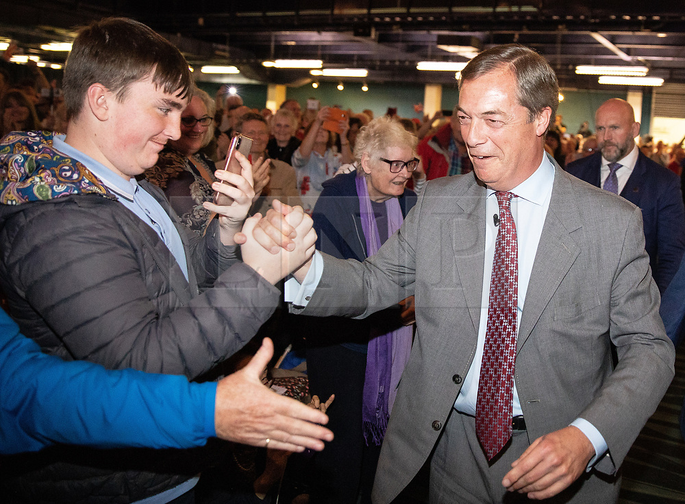 """© Licensed to London News Pictures . 22/09/2018. Bolton, UK. NIGEL FARAGE enters the auditorium to speak . Pro Brexit campaign group Leave Means Leave host a """" Save Brexit """" and """" Chuck Chequers """" rally at the University of Bolton Stadium , attended by leave-supporting politicians from a cross section of parties , including Conservative David Davis , former UKIP leader Nigel Farage and Labour's Kate Hoey . Photo credit: Joel Goodman/LNP"""