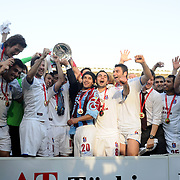 Jubilant Trabzonspor players Gustavo COLMAN (C), Selcuk INAN (C), Alan Carlos Gomes Da COSTA (2ndR) lifting up the cup at the ceremony during their after the Turkey Cup final match Trabzonspor between Fenerbahce at the GAP Arena Stadium at Urfa Turkey on wednesday, 05 May 2010. Photo by TURKPIX