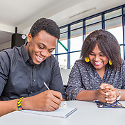 INDIVIDUAL(S) PHOTOGRAPHED: Isaac Biosse (left) and Cerene Mureithi. LOCATION: Shortlist Office, Daykio Plaza, Ngong Road, Nairobi, Kenya. CAPTION: Employees Isaac and Cerene sit down for a Monday morning meeting at Shortlist's Nairobi office.