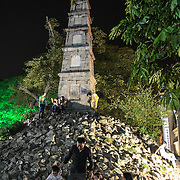 A commemorative tower and shrine, known as Cua Hang Cap Tui Hq, on a mount of stone next to Hoan Kiem Lake in Hanoi, Vietnam.