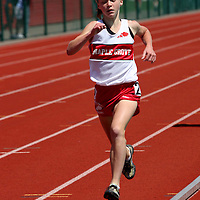 7th grader Caroline Benson from Maple Groves wins the 1500 meters photo by Mark L. Anderson