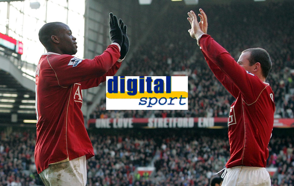 Photo: Paul Thomas.<br /> Manchester United v Manchester City. The Barclays Premiership. 09/12/2006.<br /> <br /> Goal scorers Louis Saha (L) and Wayne Rooney of Man Utd give each other a high five after Saha's goal.