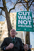 With his back to the Ministry of Defence main building in Whitehall, an elderly gentleman protests about war not welfare in Whitehall before Saudi Crown Princes Mohammed bin Salmans meeting with Prime Minister Theresa May in Downing Street, on 7th March 2018, in London England.