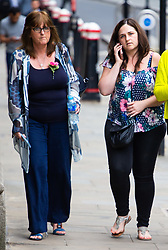 Roz Wickens, left, mother of Charlotte Brown leaves the Old Bailey with her daughter Katie after watching the trial of Jack Shepherd from Abergavenny, Wales, who is absent from his trial on charges of manslaughter following the death of Charlotte 'Charli' Brown, 24, who died following the capsizing of Shepherd's speedboat during a late night cruise on the River Thames in 2015. London, July 04 2018.