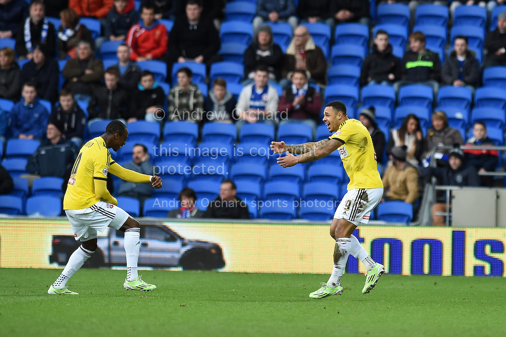 Andre Gray of Brentford (r) celebrates after he scores his teams 2nd goal. Skybet football league championship match, Cardiff city v Brentford at the Cardiff city stadium in Cardiff, South Wales on Saturday 20th December 2014<br /> pic by Andrew Orchard, Andrew Orchard sports photography.