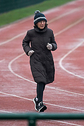 © Licensed to London News Pictures. 07/01/2021. London, UK. An elderly woman exercising in freezing, early morning conditions at Paddington Recreation Ground in West London, during a third national Lockdown. Photo credit: London News Pictures.