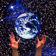 Child's Hands Holding Earth