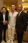 Christopher Bailey, Rupert Everett and Michael Roberts. Christopher Bailey hosts a party to celebrate the launch of ' The Snippy World of New Yorker Fashion Artist Michael Roberts' Burberry, New Bond St.  London. 19  September 2005. ONE TIME USE ONLY - DO NOT ARCHIVE © Copyright Photograph by Dafydd Jones 66 Stockwell Park Rd. London SW9 0DA Tel 020 7733 0108 www.dafjones.com