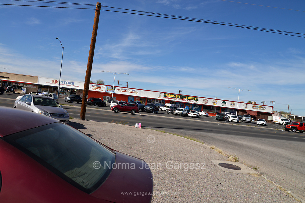 Tucson, Arizona, USA; November 17, 2018; South 12th Avenue is home to many strip malls on Tucson's south side.  Students, nonprofit and grassroots organizations construct green infrastucture that will capture storm water to water trees they are planting to improve the landscape at nearby STAR Academic High School.  PHOTO CREDIT: Norma Jean Gargasz