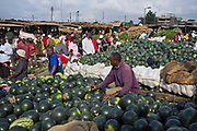 A water melon stall in the Makongeni market, Thika, Kenya. The market work closely with Afcic, Action for children in conflict, and are trying to encourage the kids to go to school. The manager has banned children from working in the market during school hours.