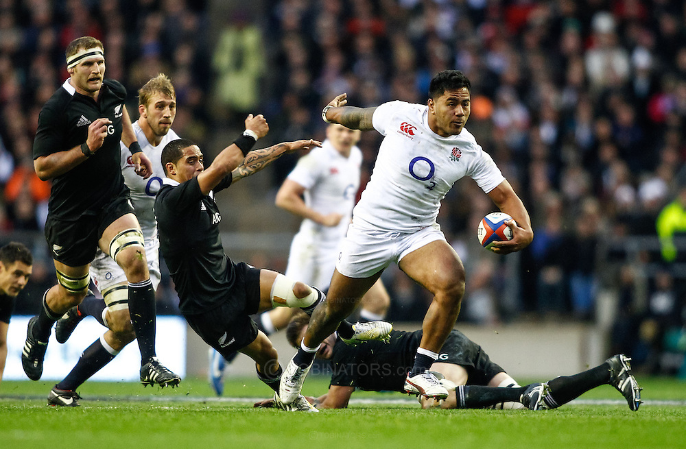 Picture by Andrew Tobin/SLIK images +44 7710 761829. 2nd December 2012. Manu Tuilagi of England hands off Aaron Smith of New Zealand during the QBE Internationals match between England and the New Zealand All Blacks at Twickenham Stadium, London, England. England won the game 38-21.