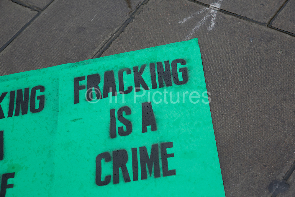 London, UK. Sunday 29th November 2015. Peoples March for Climate Justice and Jobs demonstration. Demonstrators gathered in their tens of thousands to protest against all kinds of environmental issues such as fracking, clean air, and alternative energies, prior to Major climate change talks. Fracking is a crime sign.