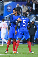 Defenders Raphael Varane and Mamadou Sakho of France at the end of the International Friendly Game 2016 football match between France and Russia on March 29, 2016 at Stade de France in Saint Denis, France - Photo Jean Marie Hervio / Regamedia / DPPI