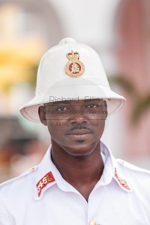 A member of the Royal Bahamas Police wearing a Wolseley pith helmet patrols Parliament Square Nassau, Bahamas.