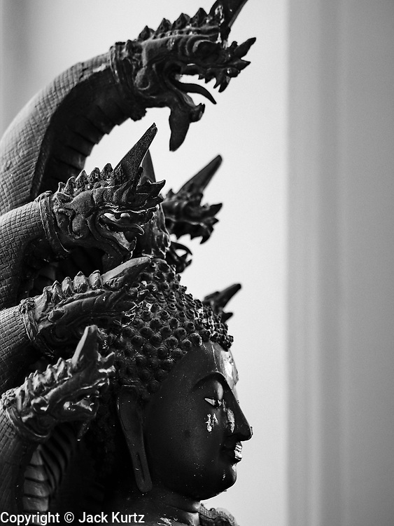 10 APRIL 2017 - BANGKOK, THAILAND:  A statue of the Buddha seated under a naga (mystical serpent) at Wat Ratchanatdaram, a Buddhist temple in Phra Nakhon district, Bangkok. It means Temple of the Royal Niece, the temple was built on the orders of King Nangklao (Rama III) for the princess granddaughter, Somanass Waddhanawathy in 1846.      PHOTO BY JACK KURTZ