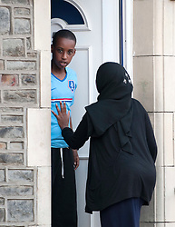 © Licensed to London News Pictures. 30/09/2014. Bristol, UK.  Visitors to the home in Easton, Bristol of the missing girl Yusra Hussien who is thought to be trying to reach Syria and the Islamic State, having left Bristol last week and been tracked from Heathrow to Istanbul. Photo credit : Simon Chapman/LNP