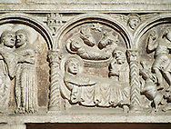 Scenes from the life of Christ - The Nativity - the work of the sculptor Nicholaus, on the main portal  of the 12th century Romanesque Ferrara Duomo, Italy . Ferrara Cathedral (Basilica Cattedrale di San Giorgio, Duomo di Ferrara) is a Roman Catholic cathedral and minor basilica in Ferrara, Northern Italy. The original Romanesque design of Ferrara Cathedral is manifest in the façade. In the centre of the façade of Ferrara Cathedral is a porch, supported by two columns with Atlases seated on lions at the bases. It is decorated with a Last Judgement by an unknown master and a loggia with a Madonna and Child (a late Gothic addition). The portal of Ferrara Cathedral is the work of the sculptor Nicholaus, a pupil of Wiligelmus. The lunette shows Saint George, patron saint of Ferrara, slaying the dragon; scenes from the Life of Christ appear on the lintel. The jambs framing the entrance of Ferrara Cathedral are embellished with figures depicting the Annunciation and the four prophets who foretold the coming of Christ.<br /> <br /> Visit our ITALY PHOTO COLLECTION for more   photos of Italy to download or buy as prints https://funkystock.photoshelter.com/gallery-collection/2b-Pictures-Images-of-Italy-Photos-of-Italian-Historic-Landmark-Sites/C0000qxA2zGFjd_k<br /> <br /> If you prefer to buy from our ALAMY PHOTO LIBRARY  Collection visit : https://www.alamy.com/portfolio/paul-williams-funkystock/ferrara.html .