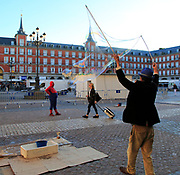 Street performer creating huge soap bubbles, Plaza Mayor, Madrid, Spain central square tourist attraction in the heart of the city