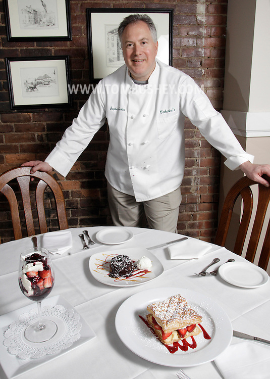 Stephen Serkes, owner of Catherine's restaurant in Goshen,  sits at a table with three of the desserts which will be on the menu for Valentine's Day. Feb. 11, 2011.