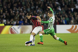 November 8, 2018 - Seville, Spain - RICARDO RODRIGUEZ of Milan (L ) vies for the ball with Lo Celso .jb (R ) during the Europa League Group F soccer match between Real Betis and AC Milan at the Benito Villamarin Stadium (Credit Image: © Daniel Gonzalez Acuna/ZUMA Wire)