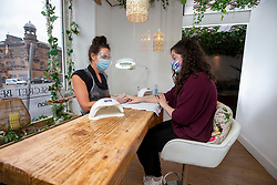 22JUL20<br /> Laura Taylor at The Secret Beauty Garden, Morrison St, Edinburgh. Pic with customer Michelle Curtin at the nail bar. The salon opened today for the first time since lockdown.