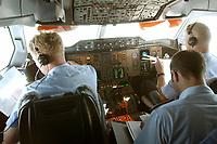 """10 AUG 2003, BERLIN/GERMANY:<br /> Pilot (L), Bordtechniker (M), und Copilot (R), im Cockpit des Airbus A310 """"Konrad Adenauer"""" der Flugbereitschaft der Bundesluftwaffe waehrend einem Flug von Berlin nach Usbekistan<br /> IMAGE: 20030810-01-022<br /> KEYWORDS: Bundeswehr, Streitkraefte, Streitkräfte, Praesidentenmaschine, Präsidentenmaschine, Luftwaffe, Airforce No 1, Flugzeug, Plane,"""