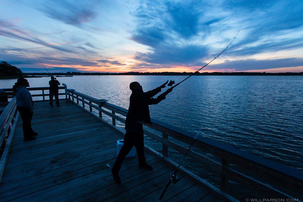 John Rogers of Suffolk, Va., fishes for croaker from the Nansemond River at Sleepy Hole Park in Suffolk on May 9, 2017. The park added the fishing pier along with an accessible kayak launch in 2016. (Photo by Will Parson/Chesapeake Bay Program)