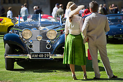 © London News Pictures. 07/09/2012. Windsor, UK . A couple admire one of 60 of the rarest motorcars from around the world at Windsor Castle in Berkshire for the WIndsor Castle Concours Of Elegance on September 07, 2012. The three day event is open to the public on Saturday and Sunday. Photo credit: Ben Cawthra/LNP