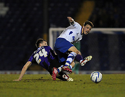 Bury's Andrew Tutte is tackled by Bristol Rovers' Ollie Clarke - Photo mandatory by-line: Dougie Allward/JMP - Mobile: 07966 386802 01/04/2014 - SPORT - FOOTBALL - Bury - Gigg Lane - Bury v Bristol Rovers - Sky Bet League Two