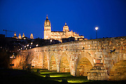 Night view of the cathedral with the Roman bridge in the foreground. Salamanca, Spain during Semana Santa (Holy Week).