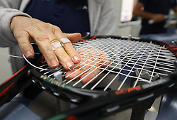 A racket being strung in the Stringing Room on day two of the Wimbledon Championships at the All England Lawn Tennis and Croquet Club, Wimbledon. PRESS ASSOCIATION Photo. Picture date: Tuesday July 4, 2017. See PA story TENNIS Wimbledon. Photo credit should read: Philip Toscano/PA Wire. RESTRICTIONS: Editorial use only. No commercial use without prior written consent of the AELTC. Still image use only - no moving images to emulate broadcast. No superimposing or removal of sponsor/ad logos.
