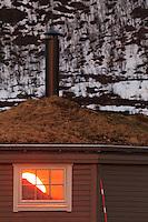 Solnedgang over Senjafjellene sett fra Andørja, snart midnattssol - Sunset over the Senja mountains as seen from Andørja. It will soon be midnight sun..Solnedgang speiler seg i vindu på en grillstue Andørja, snart midnattssol - Sunset seen fas mirror image in a window. It will soon be midnight sun