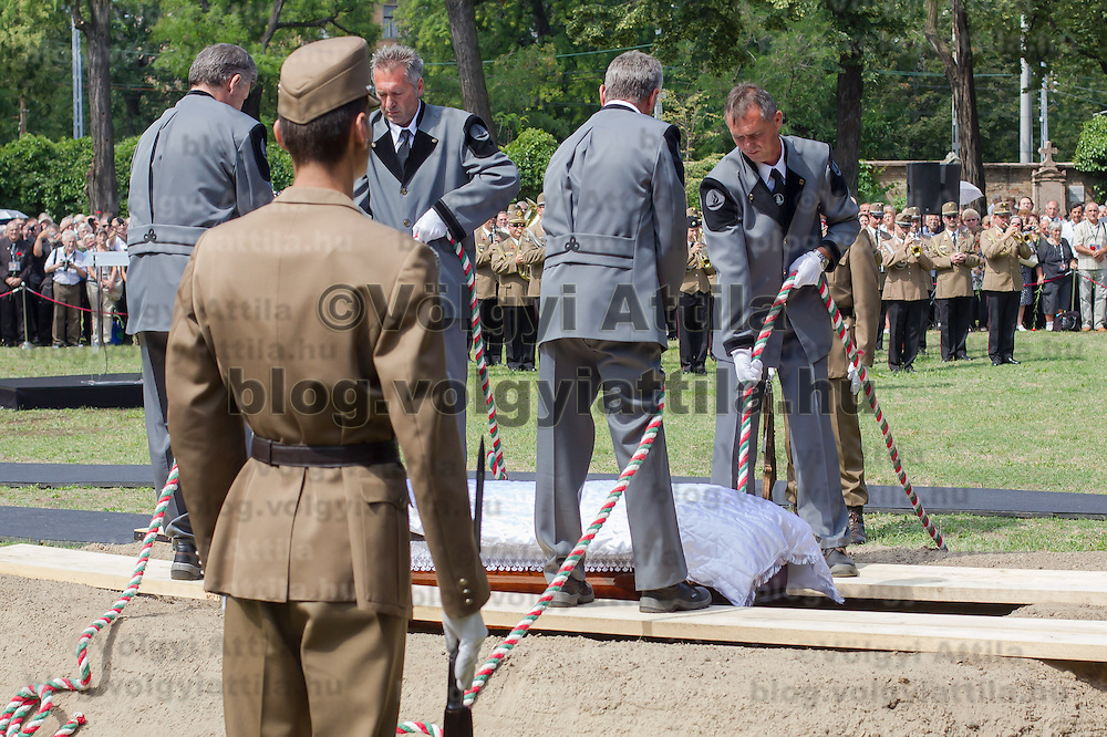 Soldiers lower the coffin during the funeral of Gyula Horn former prime minister of Hungary in Budapest, Hungary on July 08, 2013. ATTILA VOLGYI