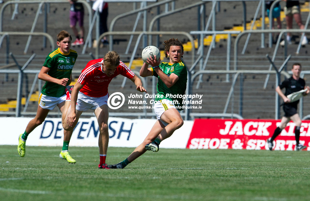 24-07-21. Meath v Louth - Leinster MFC Semi-Final at Pairc Tailteann, Navan.<br /> Shaun Leonard, Meath in action against Evan Wynne, Louth in the Leinster MFC Semi-Final.<br /> Photo: John Quirke / www.quirke.ie<br /> ©John Quirke Photography, 16 Proudstown Road, Navan. Co. Meath. (info@quirke.ie / 046-9028461 / 087-2579454).