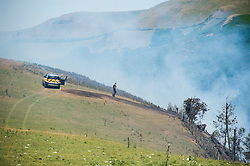©Licenced to London News Pictures<br /> Aberystwyth Wales UK, June 27 2018<br /> <br /> UK Weather:  A fire officer monitors a forest fire that started yesterday and  is still raging along the steep hillsides of the Rheidol Valley, a few miles inland of Aberystwyth in Mid Wales.<br /> The terrain makes it impossible for fire-crews to get their vehicles close tot he flames, and the fire is being dealt with by a specialist helicopter team who are dropping tons of water, scooped up from the river below, onto the burning trees.<br /> <br /> <br /> photo credit:  Keith Morris/ / LNP