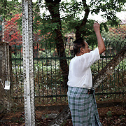 May 09, 2013 - Yangon, Myanmar: A local resident exercises at the sound of music from a portable radio, in the early hours of the day, beside a fenced garden in central Yangon. (Paulo Nunes dos Santos/Polaris)