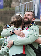 Greater London. United Kingdom, Coach Rob BAKER, celebrates with Olivia COFFEY. University Boat Races , Cambridge University vs Oxford University. Putney to Mortlake,  Championship Course, River Thames, London. <br /> <br /> Saturday  24.03.18<br /> <br /> [Mandatory Credit  Intersport Images]